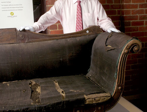 TMAG Director Bill Bleathman and the Hamilton Inn colonial couch. Image by Collection Tas Museum and Art Gallery.