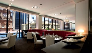 The ala carte section of Thyme2 restaurant, with stunning views out over Anzac Square. Image by Sofitel Brisbane