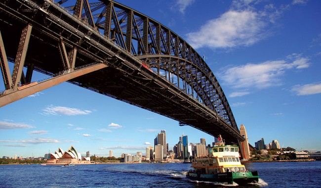 Walk across the Bridge or take a ferry for cheap and stunning views of the Harbour city. Image by Tourism NSW.