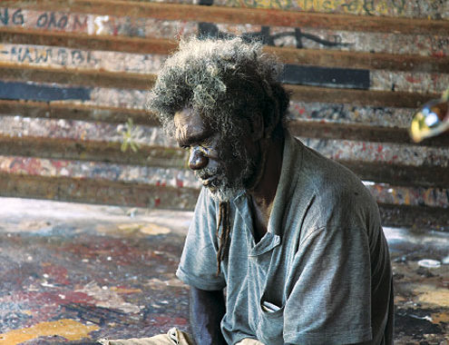 Glen Namundja paints on his own at the Injalak Arts Centre.