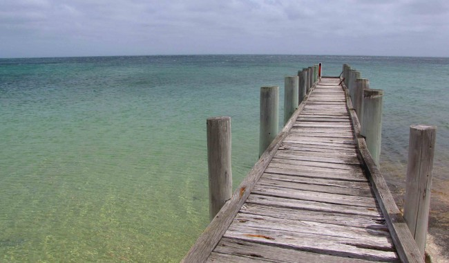 Wooden jetty on the 6km-long Whitemark Beach